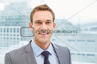 Close up portrait of smart young businessman in suit