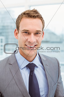 Close up portrait of young businessman in suit