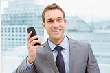 Portrait of businessman using mobile phone