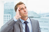 Businessman with severe headache at office