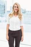 Beautiful young businesswoman in office