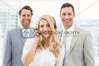 Portrait of happy young business people in office