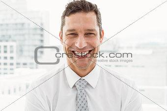 Close up portrait of happy businessman