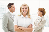 Businesswoman with colleagues behind in office