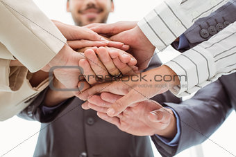 Close up of executives holding hands together