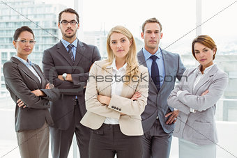Business people with arms crossed in office