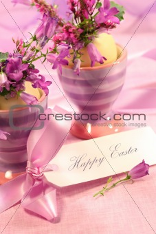 Purple flowers in eggs cups