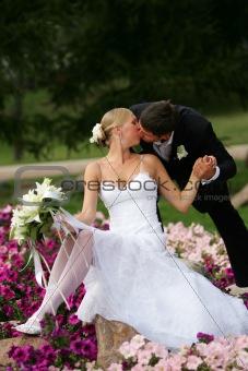 Beautiful newlyweds kissing