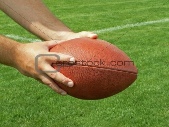 holding a football