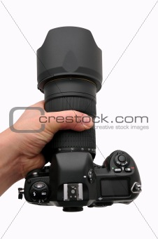 Camera SLR professional with zoom in hand, isolated