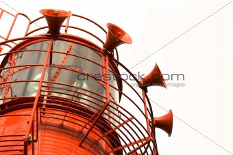 Bright red lighthouse with fog horns on white background