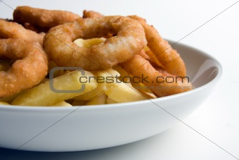 A bowl of fries and onion rings
