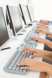 Hands using computers in office