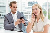 Business people using mobile phones