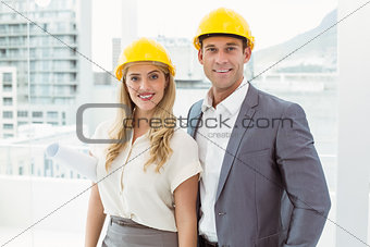 Portrait of colleagues wearing hard hats