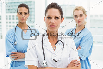Portrait of confident female doctors with arms crossed