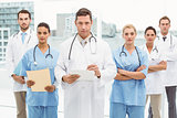 Portrait of confident doctors with arms crossed