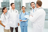Male and female doctors in meeting