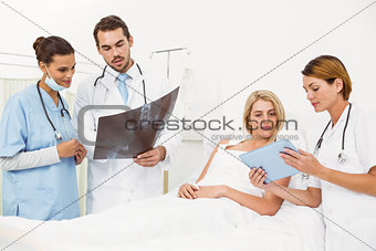 Portrait of doctors and patient with x-ray