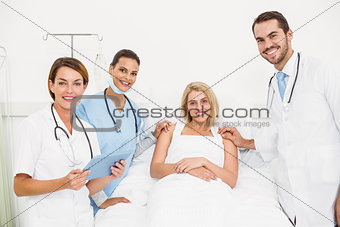 Portrait of doctors visiting patient