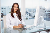 Beautiful businesswoman sitting at office desk