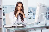 Beautiful businesswoman at office desk
