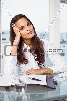 Beautiful businesswoman at office desk