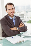Handsome businessman sitting at office desk