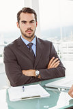 Handsome young businessman at office desk