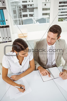 Business people with diary in office