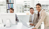 Business people using laptop and computer in office