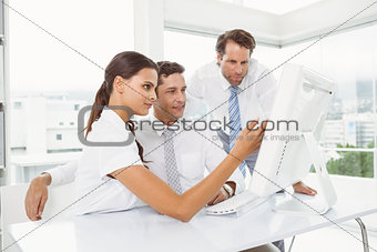 Business people using computer in office