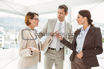 Business colleagues in discussion at office