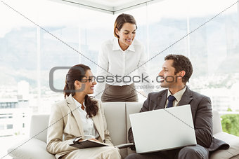 Business people in discussion in living room