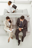 Young business people on couch