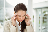 Businesswoman with headache at office
