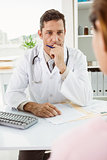 Doctor in discussion with patient at desk