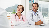 Doctors in discussion with patient in medical office