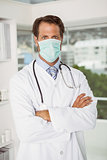 Male doctor wearing surgical mask in hospital