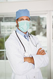 Doctor wearing surgical mask in hospital