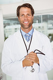 Confident male doctor in medical office
