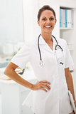 Confident female doctor with stethoscope at medical office