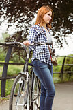 Redhead standing next to her bike