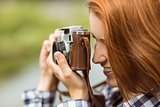Redhead woman taking a photo