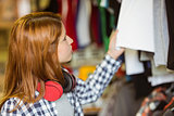 Hipster redhead looking at clothes