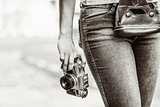 Old fashioned picture of a girl holding a retro camera