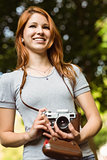 Pretty redhead holding her camera