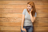 Pretty happy redhead phoning with mobile phone