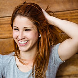 Portrait of a cheerful pretty redhead laughing