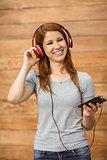 Happy enjoying woman listening with headphones to music
